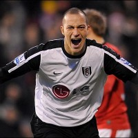 Bobby Zamora celebrates a rare Fulham triumph over United
