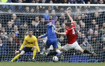 Phil Jones tackles Eden Hazard
